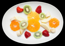 Fruit plate isolated on black Royalty Free Stock Photography