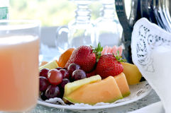 Fruit plate with juice at bed and breakfast Royalty Free Stock Photos