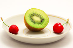 Fruit on a plate. Kiwi and cherry. Healthy food. Stock Photo