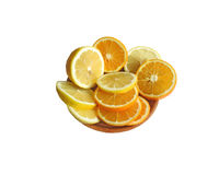 The fruit on the plate. Lemons and oranges, sliced into rings, arranged on a brown plate Royalty Free Stock Photography