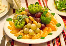 Fruit plate. On the table Royalty Free Stock Photo