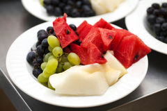 Fruit plate of watermelon melon grapes. Green blue Royalty Free Stock Image