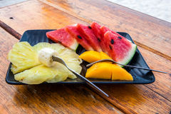 Fruit plate on the wooden table. Stock Photos