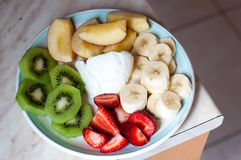 Fruit plate with yogurth. In the middle Royalty Free Stock Images