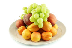 Fruit on a platter. Grapes, peaches and apricots Stock Photo