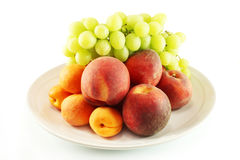 Fruit on a platter Stock Images
