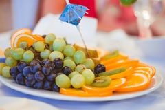 Fruits on a plate. A fruit platter is on the Banquet table Royalty Free Stock Image