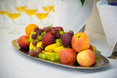 Fruit on a platter. Dessert on white. Royalty Free Stock Image
