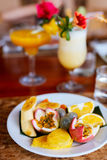 Fruit platter and exotic cocktails Royalty Free Stock Photography