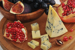 Fruit platter - figs, grapes, pomegranate and cheese Royalty Free Stock Images