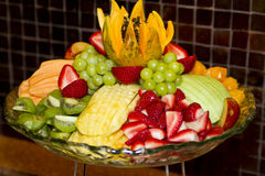 Fruit Platter Food. Colorful fruit platter containing strawberries, grapes, cantaloupe, musk melon, kiwi, apples, and more Stock Photo