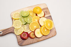Fruit Platter. A group of various colourful fruits stacked on a wooden board Stock Photography