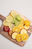 Fruit Platter. A group of various colourful fruits stacked on a wooden board Stock Photos