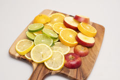 Fruit Platter. A group of various colourful fruits stacked on a wooden board Royalty Free Stock Photography