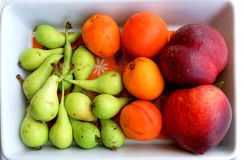 Fruit platter. Mini pears, nectarines and apricots on a fruit platter Royalty Free Stock Photo