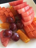 Fruit platter. A plate of fruit watermelon, grapes for healthy eating Stock Photography