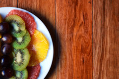 Fruit platter on a wooden table Royalty Free Stock Photo