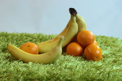 Fruit pleasure. Fruit composition with oranges and bananas Stock Photo