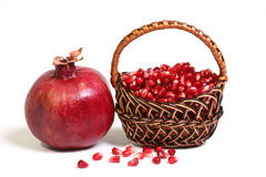 Fruit of pomegranate and his corn is in a basket. Stock Photography