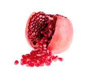 Fruit pomegranate seed poured out of the fetus in the context. Of on a white background royalty free stock images