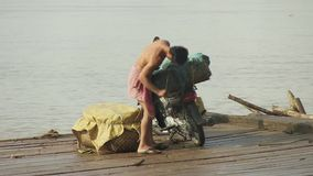 Fruit, pomelo , motorbike, mekong, cambodia, southeast asia. Southeast asia - cambodia  - mekong - october 2013. Motorbike loaded with pomelos baskets on ferry stock video