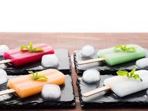 Fruit popsciles on black slate plates Stock Image