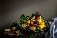 Fruit on a porcelain charger. Lemons and pomegranate on an antique Wanli Kraak porcelain charger Stock Photography