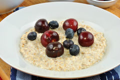 fruit with porridge on a plate Royalty Free Stock Photo