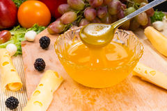 Fruit Preserve on Wood Board with Cheese and Fruit Stock Photography