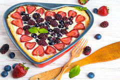 Fruit pudding with berries. And fresh mint Stock Photography