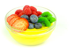 Fruit pudding. A bowl of pudding seasoned with fresh fruits stock photos