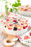 Fruit pudding(clafoutis) with berry Royalty Free Stock Images