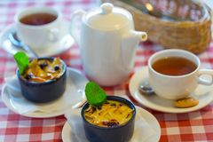 Fruit pudding with mint and tea Stock Photos