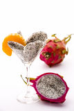 Fruit pulp of the dragon fruit in a glass. Wedges of the dragon fruit assorted in a cocktail glass and adorned with mandarine disc, which also is in harmony as Stock Photo