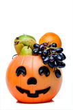 Fruit Pumpkin. A halloween pumpkin filled with delicious fruit Royalty Free Stock Photography