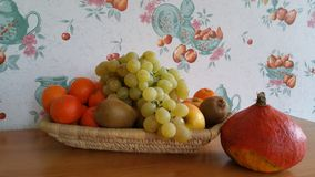 Fresh Fruit and pumpkin. Green yellow and red fresh fruit and pumpkin in basket with wallpaper background showing fruits Royalty Free Stock Photos