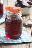 Fruit Punch Cocktail with Watermelon Garnish in Mason Jar Royalty Free Stock Image