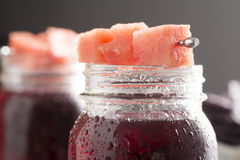 Fruit Punch Cocktail with Watermelon Garnish in Mason Jar Stock Photo