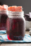 Fruit Punch Cocktail with Watermelon Garnish in Mason Jar Stock Photos