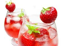 Fruit punch cocktails with strawberry Royalty Free Stock Photos