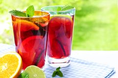 Fruit punch in glasses Stock Images