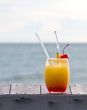 Fruit punch or mocktail. Relax with a mocktail by the beach royalty free stock photos