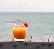 Fruit punch or mocktail. Relax with a mocktail by the beach royalty free stock photography