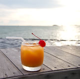 Fruit punch or mocktail. Relax with a mocktail by the beach royalty free stock photo