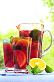 Fruit punch in pitcher and glasses Stock Photos