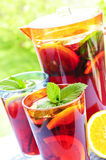 Fruit punch in pitcher and glasses Stock Photo