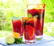 Fruit punch in pitcher and glasses stock image