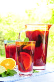 Fruit punch in pitcher and glasses Royalty Free Stock Photography