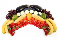 Fruit rainbow. Fruits and veggies in a rainbow shape royalty free stock image