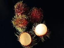 Fruit. Rambutan and cut up Stock Photos